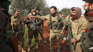 Turkish-backed Syrian fighters gather in the town of Sarmin, about 8 km southeast of the city of Idlib in northwestern Syria on February 11, 2020.