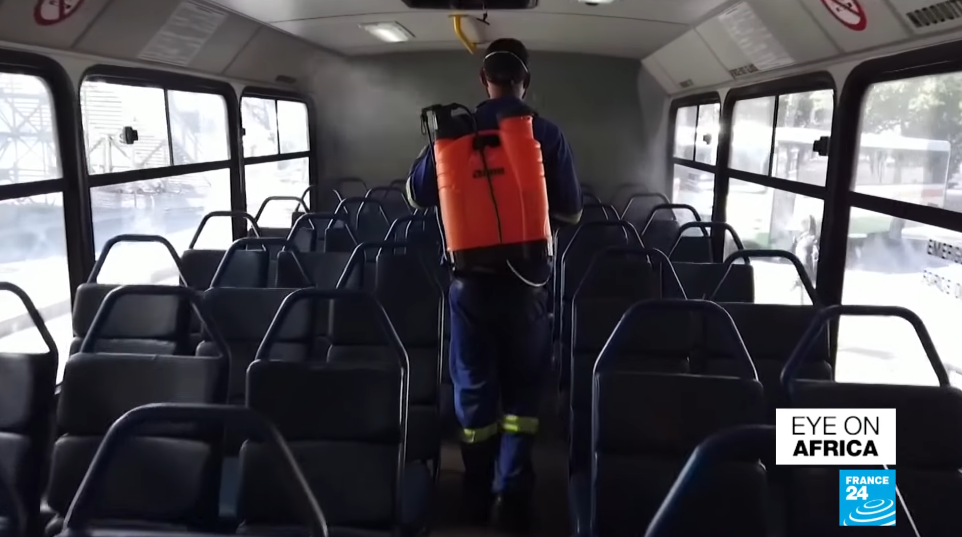 Healthworkers spray the inside of buses in South Africa, March 18 2020.