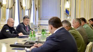 Le président ukrainien Petro Porochenko lors d'une réunion avec des représentants des forces armées, le 11 août 2016.