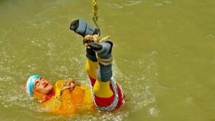 Indian stuntman Chanchal Lahiri, known by his stage name 'Jadugar Mandrake', is feared dead after being lowered into the Ganges river and failing to re-emerge