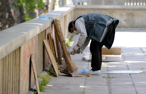 A policeman packs up a painting frame outside the Paris Modern Art Museum after five works were stolen on May 20, 2010