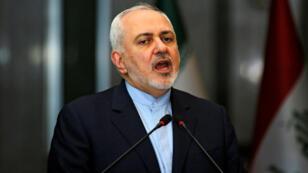 وزير الخارجية الإيراني محمد جواد ظريف خلال مؤتمر في بغداد، 13 يناير/كانون الثاني 2019