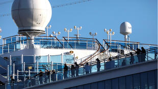 Passengers on the cruise ship Diamond Princess at Daikoku Pier Cruise Terminal in Yokohama, south of Tokyo, Japan on February 18, 2020. More than 600 people have been infected with the virus named COVID-19 on the vessel.