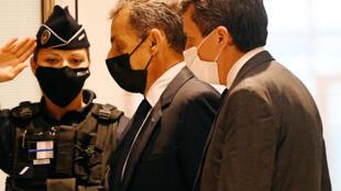 L'ancien président Nicolas Sarkozy arrive au tribunal correctionnel de Paris, le 15 juin 2021.