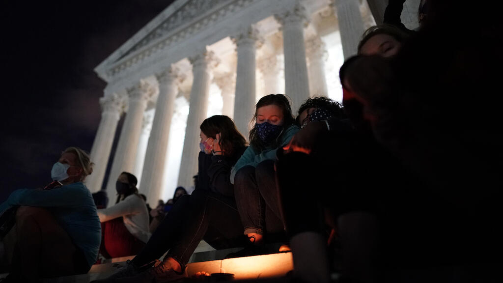 Hundreds gather outside US Supreme Court to mourn 'RBG'