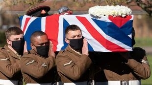Soldiers from the British Army's Yorkshire Regiment carry the coffin of Captain Tom Moore during his funeral service at Bedford Crematorium in Bedford, north of London on February 27, 2021.