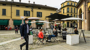Codogno residents have a drink at a cafe terrace as Italy eases its lockdown aimed at curbing the spread of coronavirus