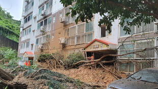 A landslide hit this apartment building in Geoje, South Korea after slamming southern Japan with record winds and heavy rains