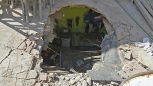 صورة التقطت في 26 آذار/مارس 2018 لمنزل أصابه صاروخ أطلقه الحوثيون على الرياض