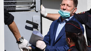 Khabarovsk region governor Sergei Furgal is escorted into a police van after a court hearing in Moscow on July 10