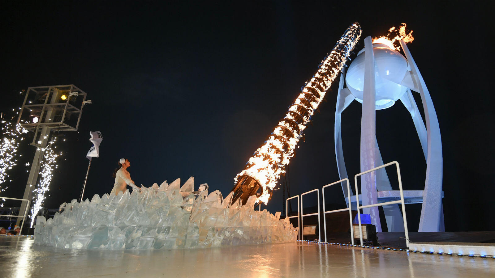 South Korean figure skater Kim Yuna, the last Olympic torch relay runner, ignites the Pyeongchang stadium cauldron with the Olympic Flame.