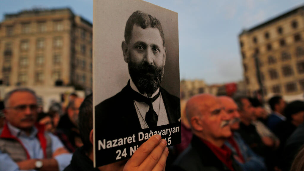 In this April 24, 2019 file photo, protesters hold portraits of Armenian intellectuals during a rally to mark the 104th anniversary of the 1915 mass slaughter of Armenians by the Ottoman Turks in Istanbul.