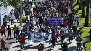 Des migrants honduriens se rendent aux États-Unis en passant par le Mexique, le 8 novembre 2018.