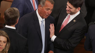 Boehner talks with Representative Paul Ryan (R-WI) at the opening session of the 114th Congress.