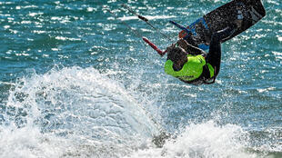 """""""I cried when I was on the water, big tears,"""" said the founder of an Italian  kite surfing school when he was allowed back out on the water"""