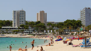 People enjoy a day out at Magaluf Beach -- but regional authorities are clamping down on tourists whose idea of a holiday is to get drunk and ignore social distancing guidelines