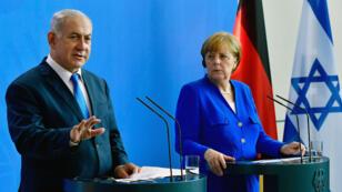 مؤتمر صحافي مشترك بين بنيامين نتانياهو وأنغيلا ميركل في برلين في 4 حزيران/يونيو 2018