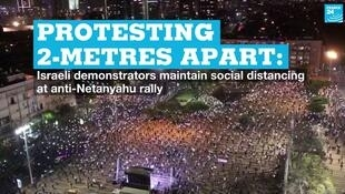 People protest in Tel Aviv, Israel, on Sunday, APril 19, 2020.