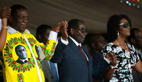 Back when they were friends: Emmerson Mnangagwa (left) and the Mugabe couple hold hands during celebrations to mark the president's birthday on February 27, 2016.