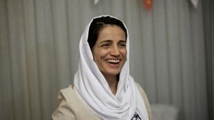 Award-winning Iranian human rights lawyer Nasrin Sotoudeh smiles at her home in Tehran on September 18, 2013, after being freed following three years in prison on state security charges