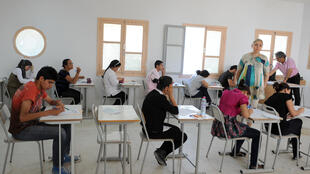 File photo of Tunisian students taking the baccalaureat (high school graduation exam) in June 6, 2012 in Tunis..