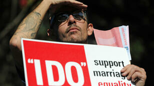 A same-sex marriage supporter rallies for the right for same-sex couples to marry