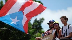 Des manifestants célèbrent la démission du gouverneur Ricardo Rossello, à San Juan, le 25 juillet 2019.