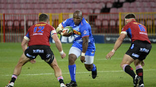 Lions centre Dan Kriel (L) and flanker Jaco Kriel (R) confront Stormers hooker Bongi Mbonambi (C) during a South African Super Rugby Unlocked match in Cape Town Saturday.
