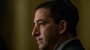 Journalist Glenn Greenwald says that despite the threats, he and his family do not plan to leave Brazil