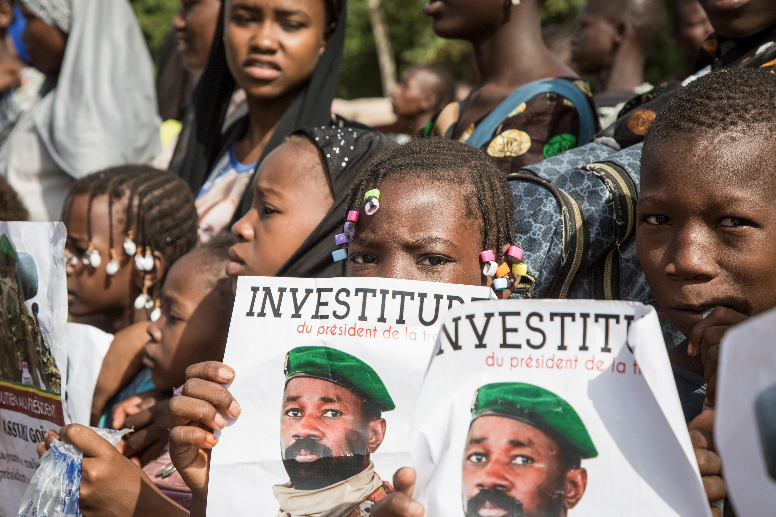 A young supporter of the new interim president, Assimi Goïta, holds a poster of the colonel on Monday, June 7, the day of his inauguration.