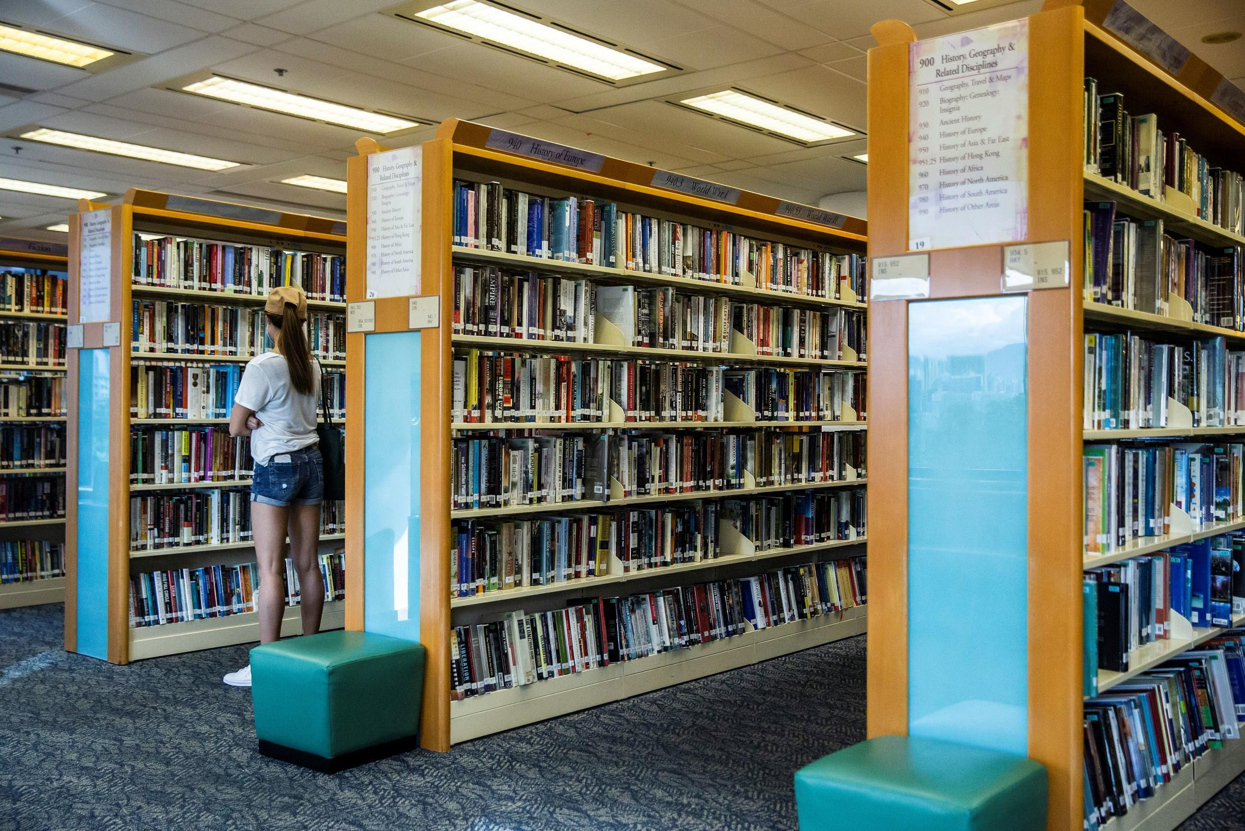 A woman looks at books in a public library in Hong Kong, China on July 4, 2020.