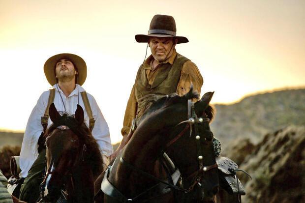 """Joaquin Phoenix et John C. Reilly dans """"Les Frères Sisters"""" de Jacques Audiard, en 2018."""