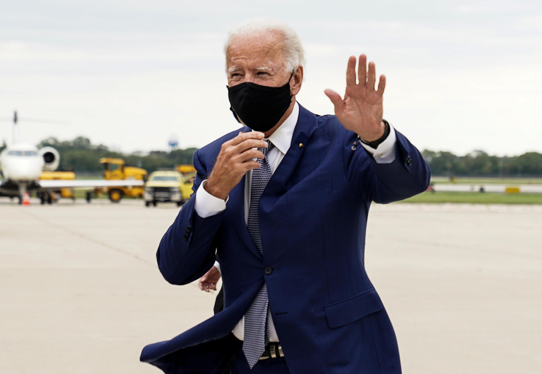 Joe Biden waves as he arrives at Milwaukee airport in Wisconsin, Sept. 3, 2020.