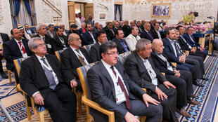 Des membres de l'opposition syrienne photographiés pendant la conférence de Riyad.