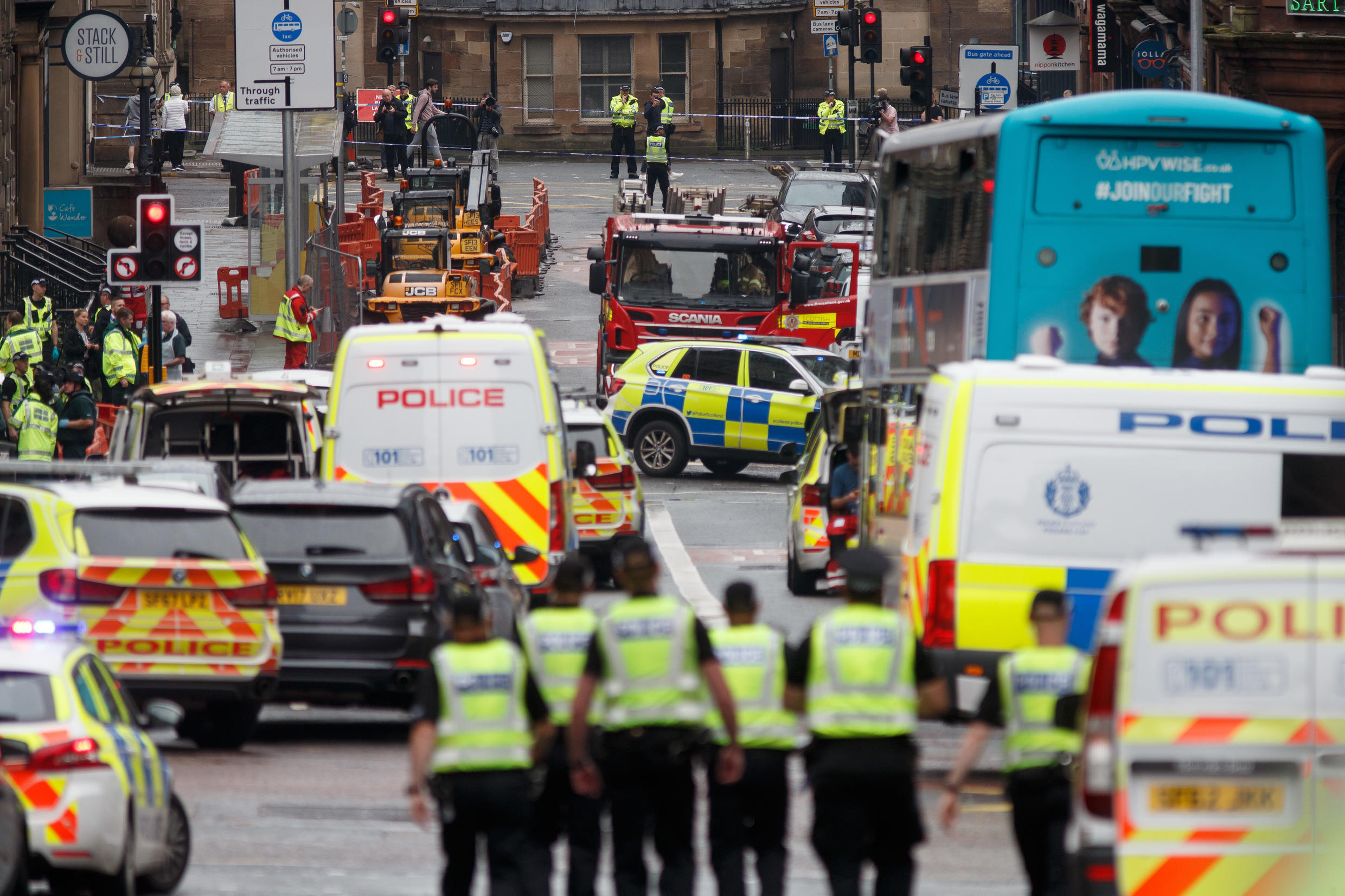 Police and emergency services respond at the scene of a fatal stabbing incident in central Glasgow on June 26, 2020.
