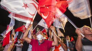 Supporters of right-wing Turkish Cypriot nationalist Ersin Tatar celebrate his win in the presidential election in northern Nicosia
