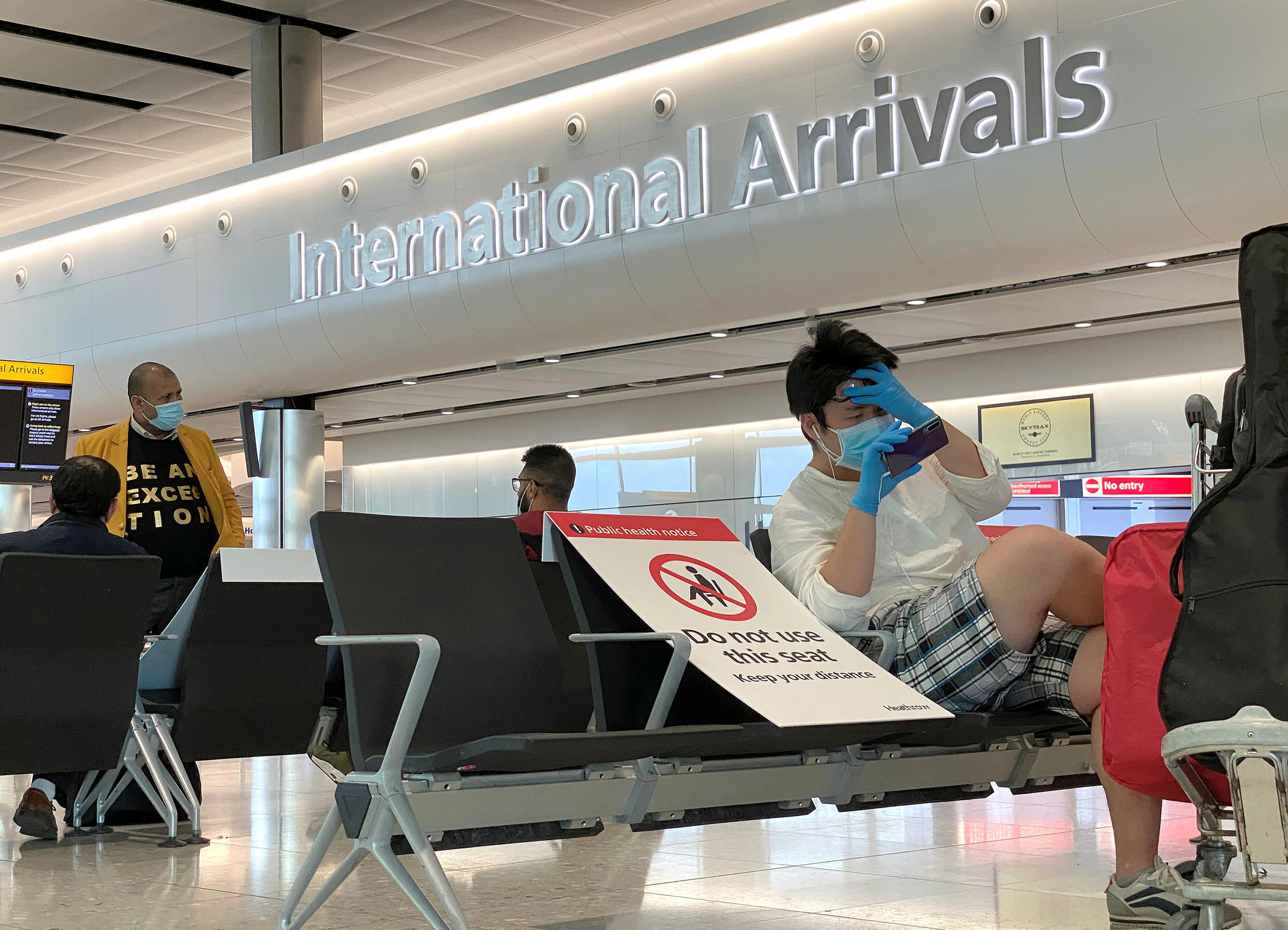 Passengers wearing protective face masks are seen at Heathrow Airport, amid the coronavirus disease (COVID-19) outbreak in London on May 22, 2020.