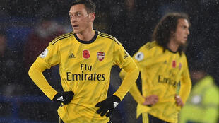 Midfielders Mesut Ozil (left) and Matteo Guendouzi are currently on the sidelines at Arsenal