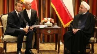 حسن روحاني وإيمانويل ماكرون أثناء لقاء في مجلس الأمن الدولي