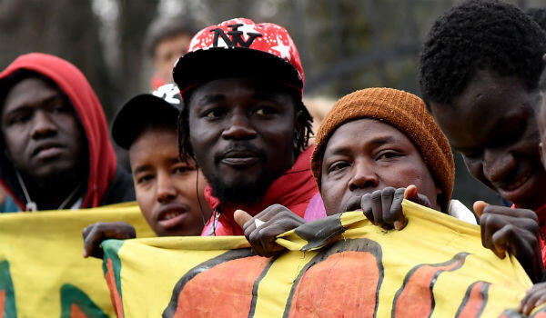 Protesters rally against racism in the city of Macerata, in central Italy, days after a far-right gunman injured several black people in a shooting rampage.