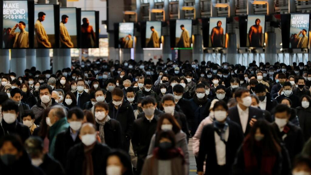 Travelers wearing protective masks, amid the coronavirus disease outbreak, head to Shinagawa Station in Tokyo, Japan, on January 8, 2021.