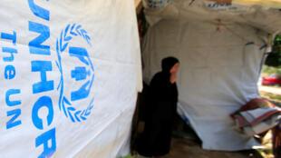 Una mujer siria descansa en un campamento de refugiados en la ciudad de Zahrani, al sur del Líbano, el 13 de junio de 2018.