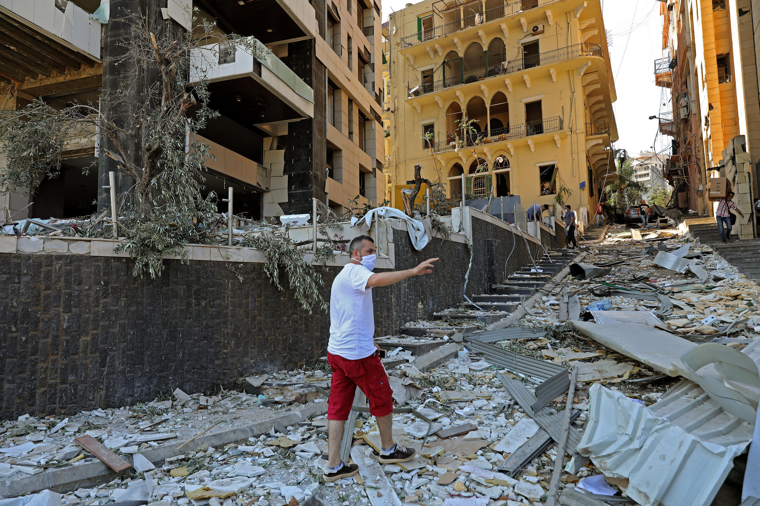 A man inspects the damage of the blast that tore through Lebanon's capital.