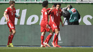 Bayern Munich Jamal Musiala (R) celebrates scoring against Wolfsburg on Saturday