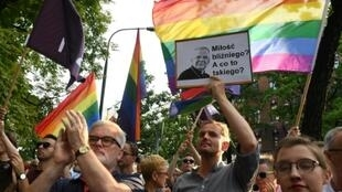 """Protesters demand the resignation of Krakow Archbishop Marek Jedraszewski who stirred outrage by warning against an """"LGBT plague"""" in Poland"""
