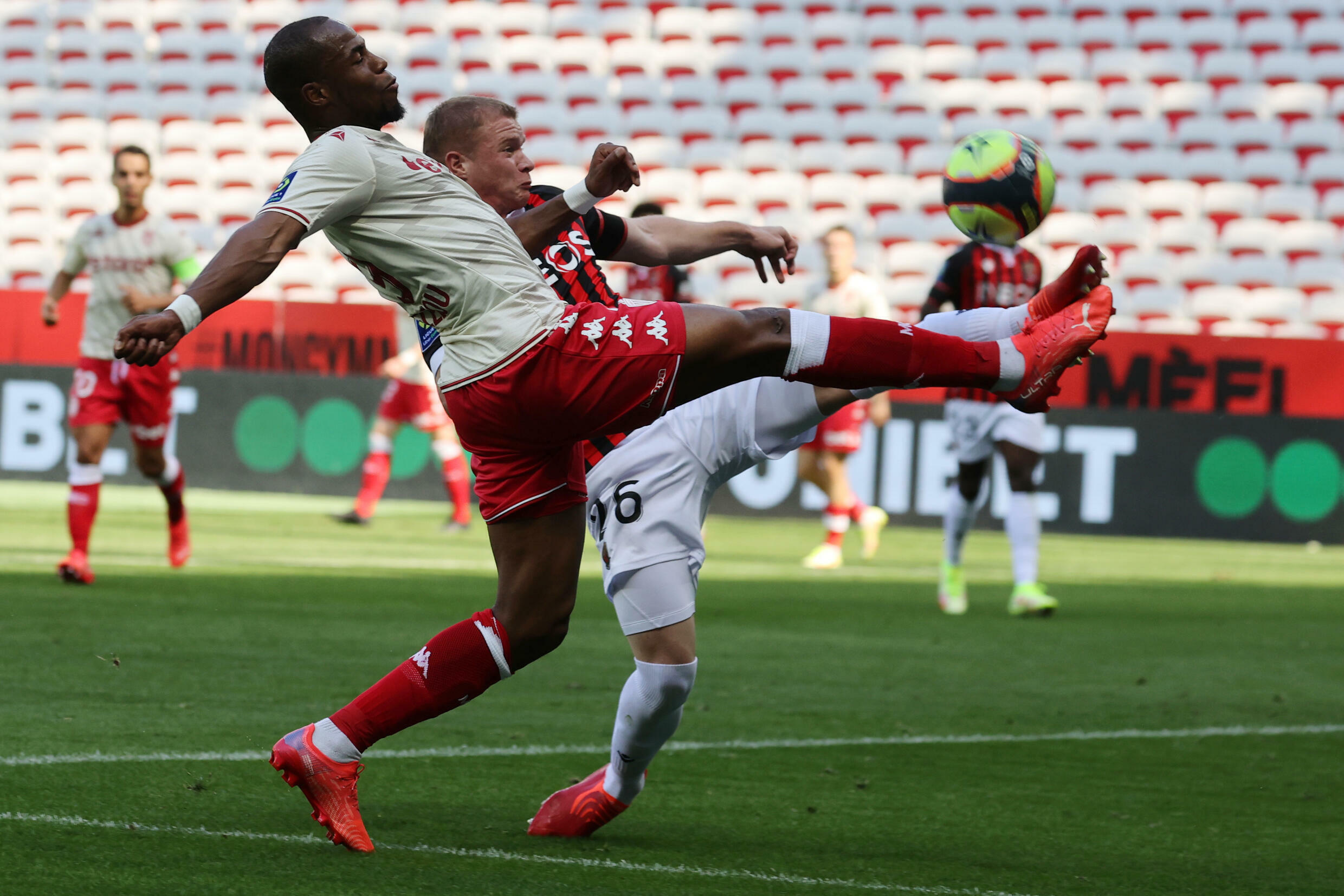 Monegasque defender Djibril Sidibé, wrestling with his Nice counterpart Melvin Bard, during their Ligue 1 match, on September 19, 2021 at the Allianz Riviera Stadium