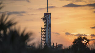 A SpaceX Falcon 9 rocket with the company's Crew Dragon spacecraft onboard seen on the launch pad at Launch Complex 39A