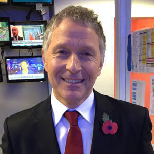 FRANCE 24's Mark Owen wearing his remembrance poppy