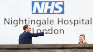 Britain's Secretary of State for Health Matt Hancock attends the opening of the NHS Nightingale Hospital in London on April 3, 2020.
