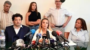 """Sofia Chouviat, centre, daughter of Cedric Chauviat, said Tuesday that """"We still don't understand why this chokehold technique still hasn't been banned."""""""